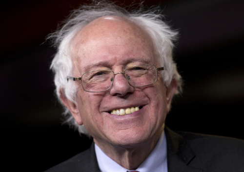 "Sen. Bernie Sanders, I-Vt., smiles as he is asked about running for president during a news conference on Capitol Hill in Washington, Wednesday, April 29, 2015. Sanders will announce his plans to seek the Democratic nomination for president on Thursday, presenting a liberal challenge to Hillary Rodham Clinton. Sanders, an independent who describes himself as a ""democratic socialist,"" will follow a statement with a major campaign kickoff in his home state in several weeks. Two people familiar with his announcement spoke to The Associated Press under condition of anonymity to describe internal planning. (AP Photo/Carolyn Kaster)"