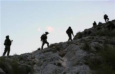 U.Ss Army soldiers climb during an early morning mountain patrol in eastern Afghanistan
