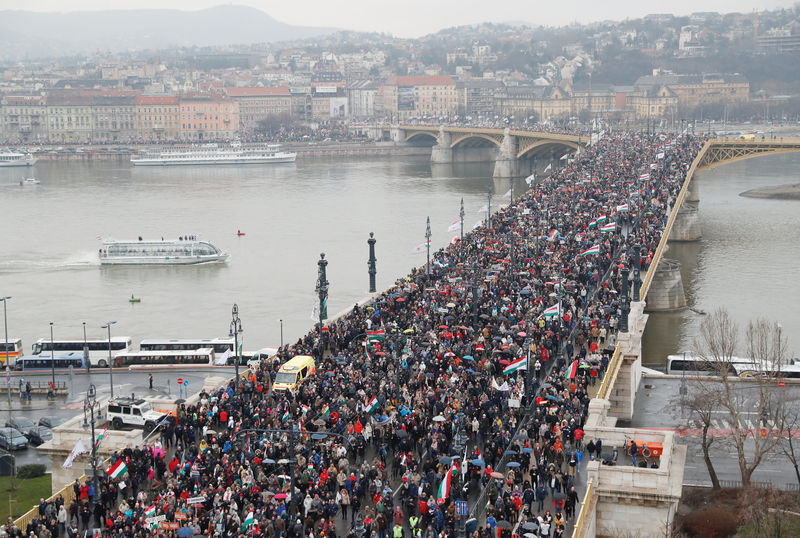 People attend Hungarian march at a pro-Orban rally during Hungary's National Day celebrations in Budapest