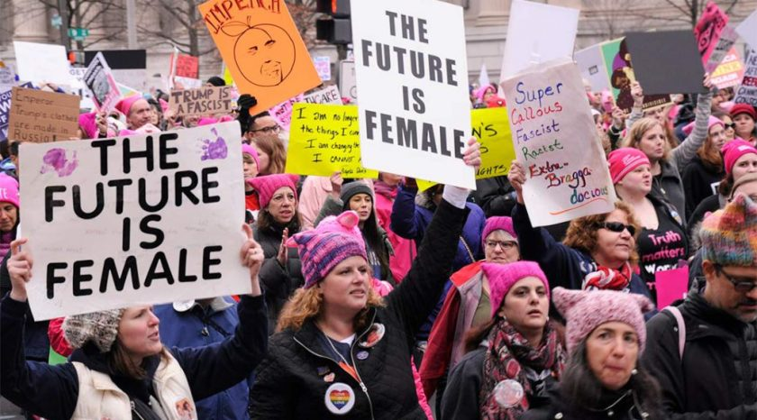 A group of feminists protesting people they disagree with
